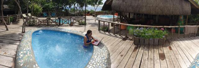 at Bohol Bee Farm while working on my laptop and chilling on the jacuzzi